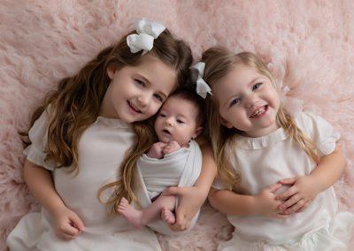 3 sisters on pink rug