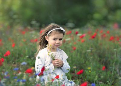 little girl in a flower field
