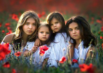 four girls in a poppy field in essex